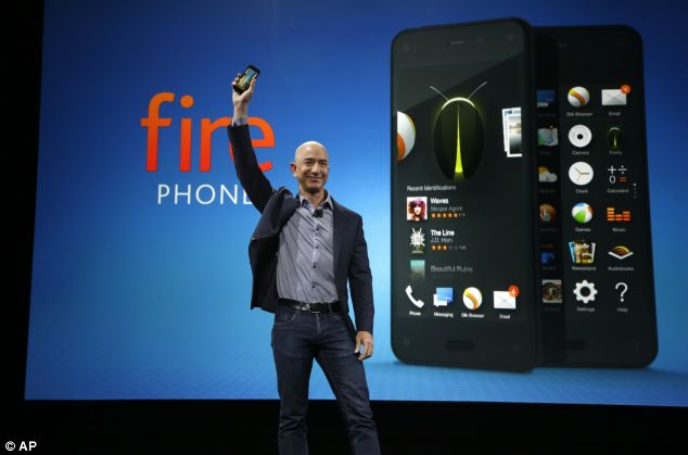 Amazon CEO Jeff Bezos holds up the new Amazon Fire Phone. The handset has a 4.7-inch display with 720p HD resolution, a quad-core Qualcomm Snapdragon processor, 2GB of RAM, and six individual camera modules to make the 3D effect work.