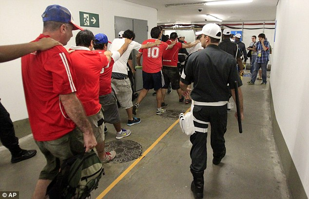 Mayhem: Chile fans caused chaos before the game when they stormed the media centre before being lef away by police