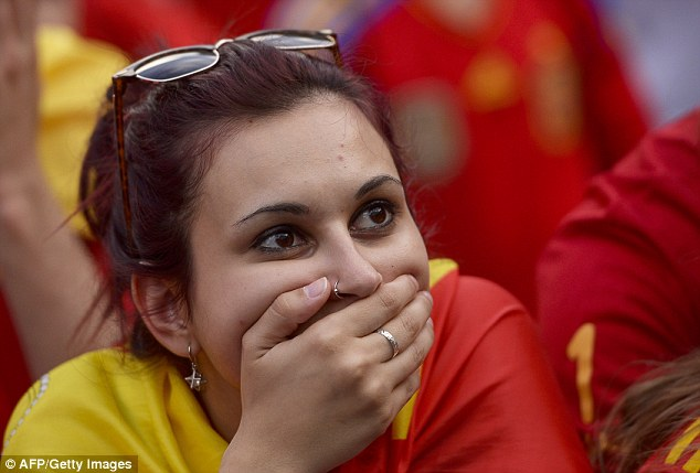 Stunned: A Spain fan looks gobsmacked after they slipped to another defeat