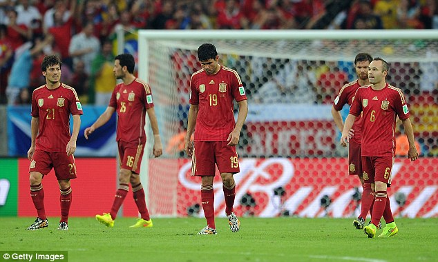 Dejected: Spain's World Cup campaign has come to a premature end