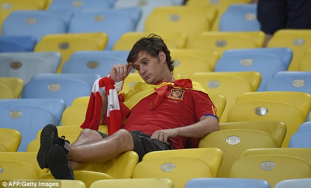 Out: A supporter struggles to accept Spain's World Cup is over