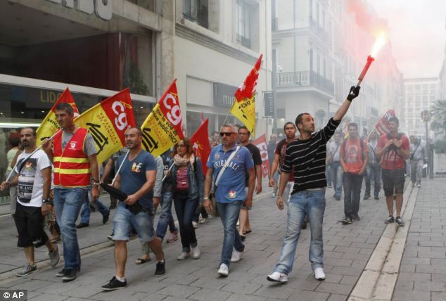Militant: Workers from the French national railway SNCF march through Marseille yesterday as part of a national rail strike