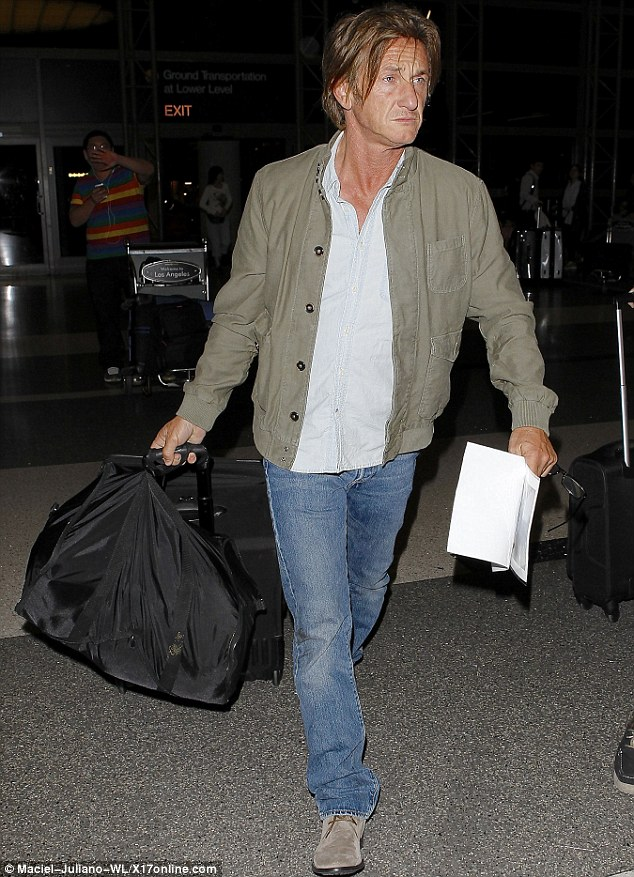 Pining for Charlize: Sean Penn looked glum as he got ready to jet out of Los Angeles on Wednesday