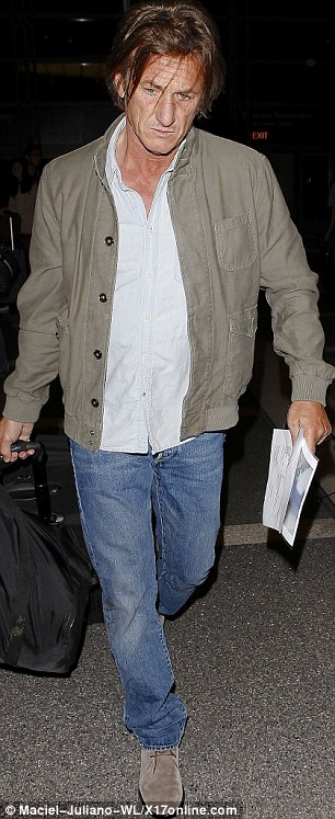 Old fashioned: It seems the ageing A-lister prefers to carry a printed copy of his travel itinerary