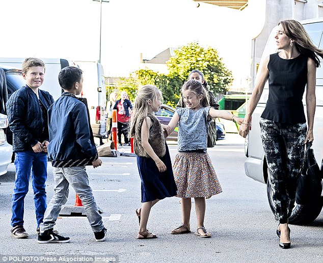 Mummy mode: Princess Mary walked hand-in-hand with her daughter inside the venue