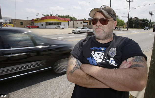 Douglas Odolecki, 43, was cited in Parma, Cleveland, on Friday night for holding a sign warning motorists of a drunken-driving checkpoint ahead