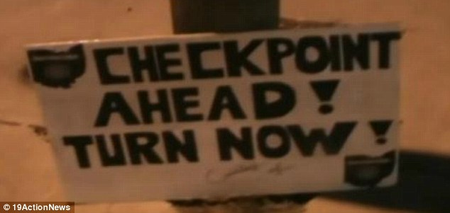 Officers cited Odolecki on Friday night after he refused to remove the 'Turn now!' portion of the sign.