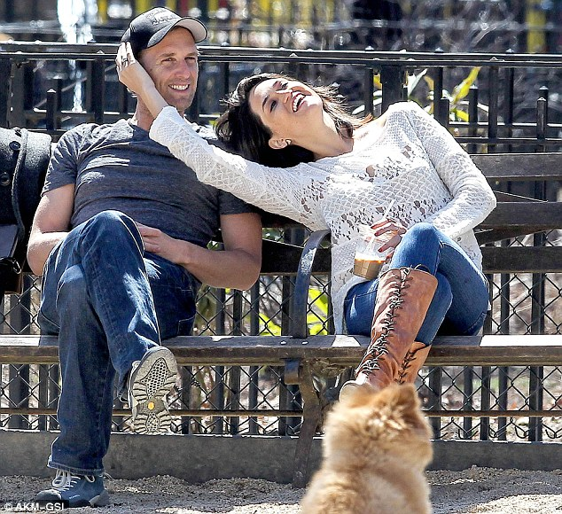What break up? Mr Lucas and Ms Henriquez were seen in New York looking rather affectionate with each other in April (pictured) after their split in January, and before they filed their divorce papers in June