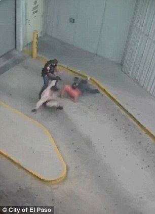 Fatal moment from another angle: Officer Flores and his guard battle to keel bodybuilder Daniel Saenz under control until he draws his weapon and the guard knocks his hand (right)