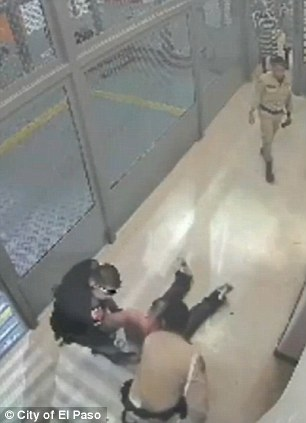 Struggle to transport: Officer Jose Flores (in uniform) and Daniel Saenz (shirtless) are seen left and right as Flores and another guardsman try and drag the prisoner to a car to drive him for medical attention