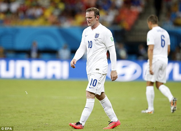Sidelined: Rooney was deployed out on the left in Saturday night's defeat by Italy