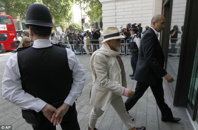 Dressed in a beige three-piece suit, pink shirt, cream scarf and wearing tinted glasses, Glitter spoke only to confirm his name, age and address during the brief hearing at Westminster Magistrates' Court