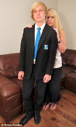 Jake Scrimshaw, 13, (pictured with his mother Sarah West) was told off for breaking the school uniform policy by having the wrong type of shoes