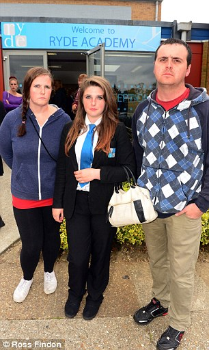 Aimee Smith (centre) with mother Sara (left) and father Sean was sent home for breaking the school uniform policy at Ryde Academy