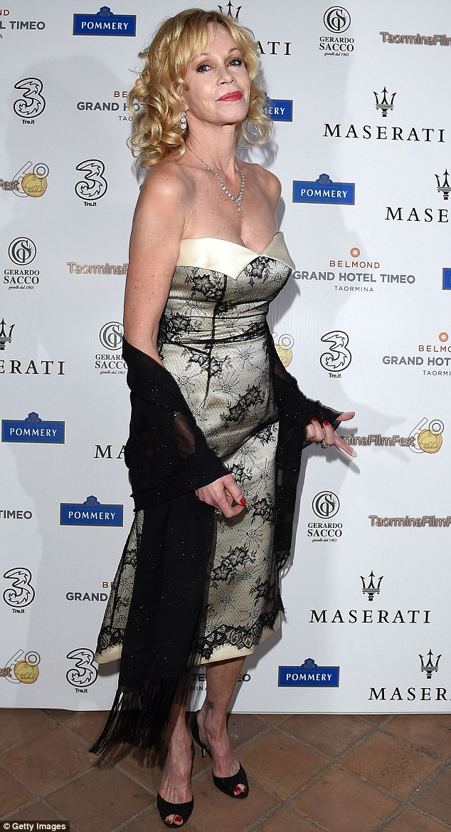 Something's missing: Melanie Griffith completely covered her Antonio Banderas love tattoo on her right arm while wearing a fetching sleeveless dress on Thursday evening while at the Taormina Film Festival in Italy