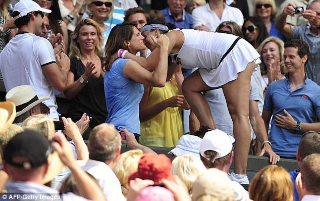 Warm embrace: Bartoli (right) hugs her then coach Maursemo (left) after her Wimbledon triumph