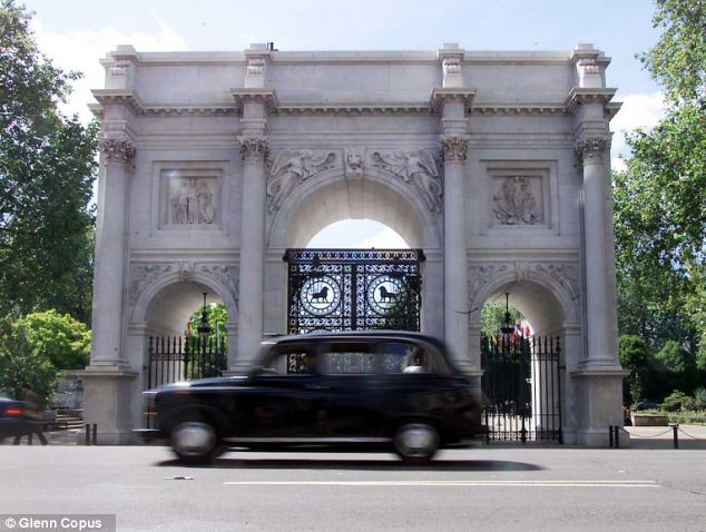The creamy white stone built Marble Arch in London