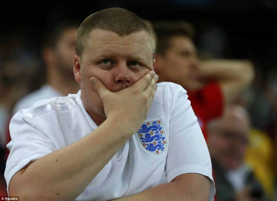 A forlorn England fan stands stunned in the Sao Paulo stadium after England's latest defeat