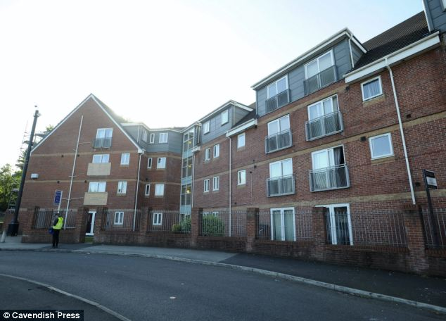 Mr Chapman's body was found 15 days after he died in a flat in Eccles, pictured. During the time the pair lived with his body, they texted his sister pretending to be the deceased and asked for £75