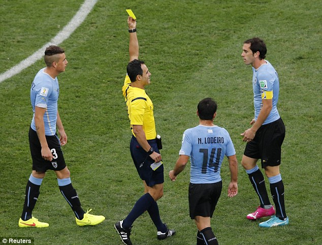 In the book: Uruguay captain Diego Godin was shown a yellow card early on for handball