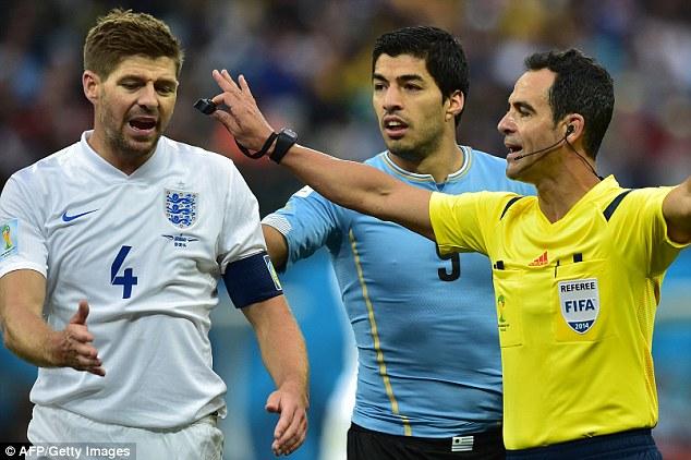Calm down: Velasco Carballo gestures towards England captain Steven Gerrard as Luis Suarez looks on