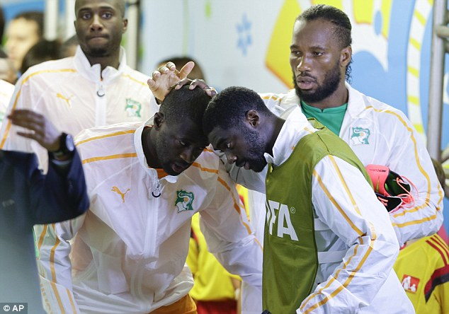 Brothers: Yaya (left, centre) and Kolo (right, centre) have lost their brother Ibrahim while on World Cup duty
