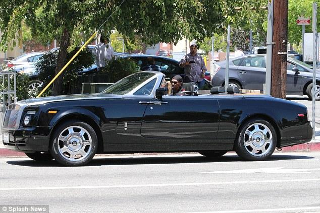 Nice wheels! Eddie pulled away in his sleek convertible after grabbing coffee
