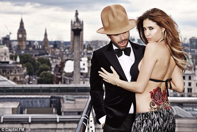 Living the dream: The pair cosied up alongside one another on a London rooftop