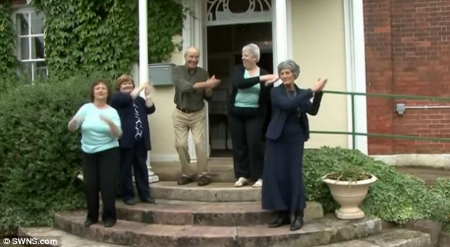 Groovy: The Gosberton House crew shake their funky stuff for their fun video on the steps outside the building
