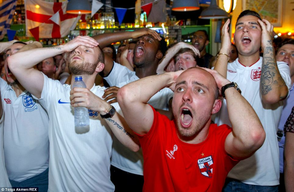 A group of men in Kick Bar, east London hold their heads in their hands as a chance goes begging in the first half