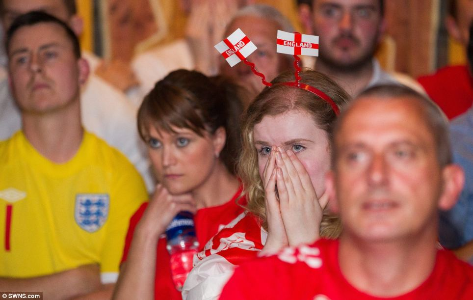 Misery is written across faces of Three Lions fans in the Walkabout Bar in Bristol after a night of excitement and disappointment