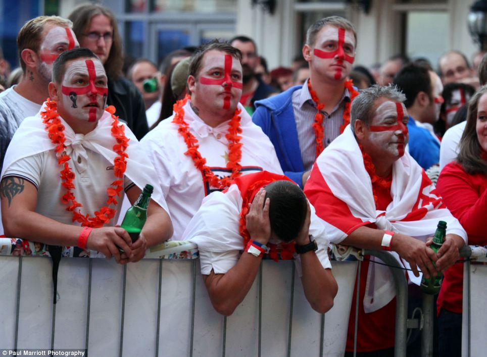 Fans in Peterborough look on dejected as Uruguay celebrate a victory that all but destroyed England's hopes of staying in Brazil