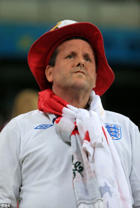 An England fan prepares to leave after the final whistle following the Group D match the Estadio do Sao Paulo, Sao Paulo