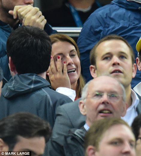 Coleen Rooney holds her head in her hands as, after making her way to Brazil to take Kai to see his father play, they are witnesses to a morale-busting 2-1 defeat