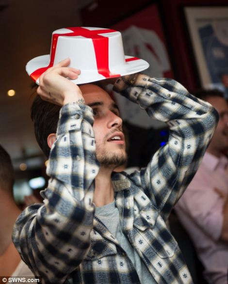A fan at a London sports bar can't watch as his team come close to scoring