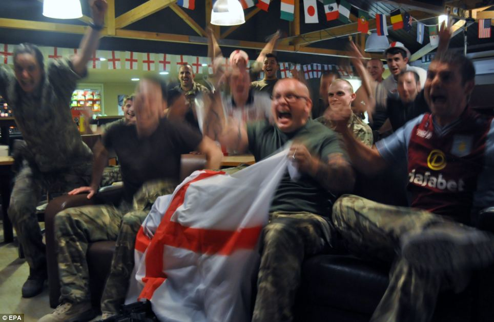 Airmen in Afghanistan celebrate as England finally score with 15 minutes still to play, raising hopes they might still win