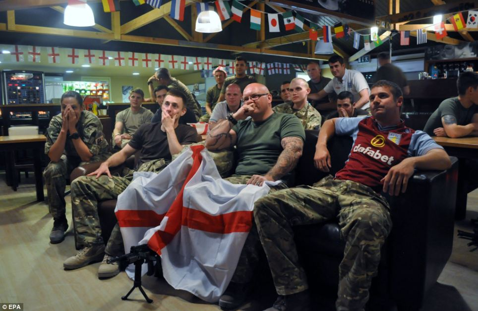 Members of the Royal Air Force's 904 Expeditionary Air Wing watching the game in their Kandahar Airbase, Afghanistan, which is home to 400 RAF personnel