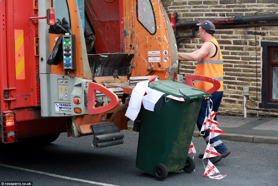 Binmen in Bradford dispose of the first of what is expected to be a surge of World Cup-related waste after England were all but knocked out of the tournament yesterday