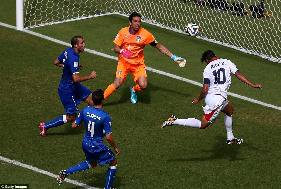 Finish: Italy's captain and goalkeeper Gianluigi Buffon watches as the ball, headed by Ruiz, heads into the back of the net