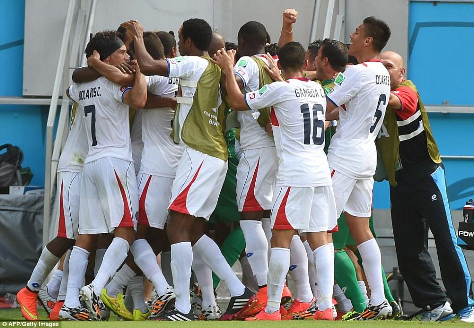 Taken the lead: The Costa Rican squad celebrates Bryan Ruiz's goal at the Pernambuco Arena in Recife
