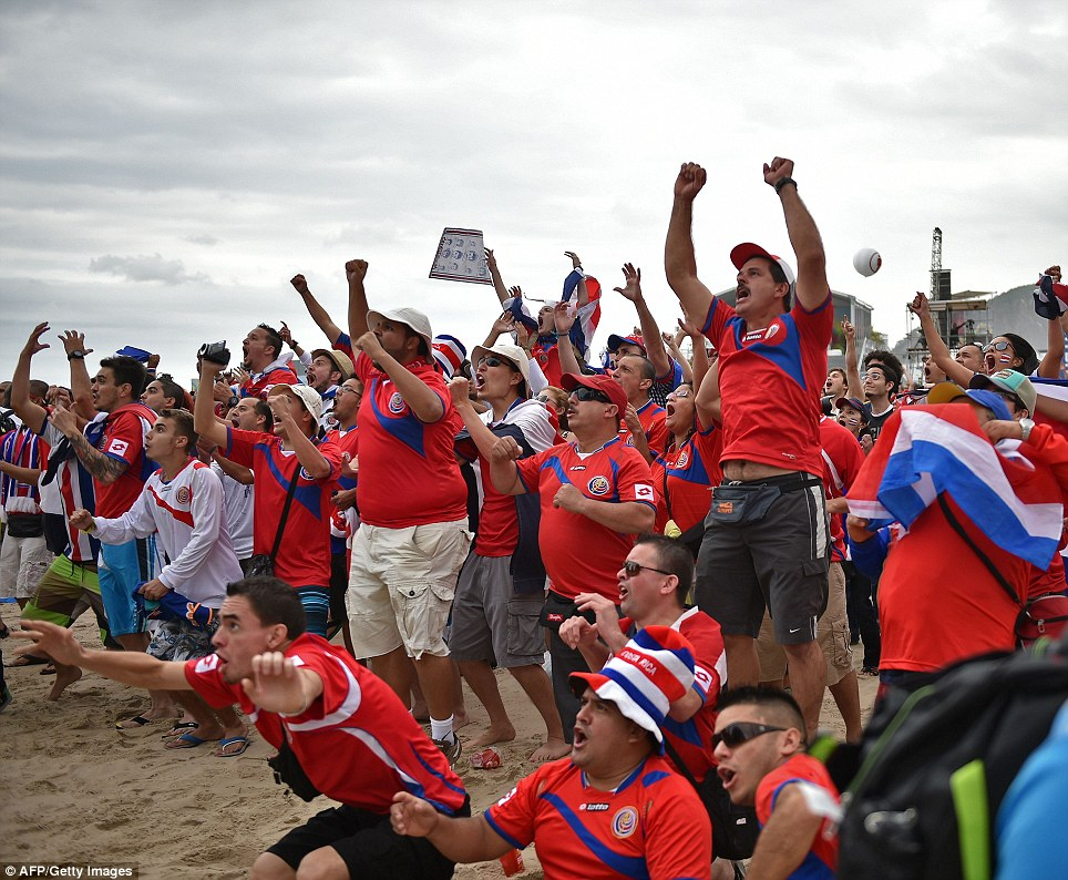 Pure joy: Costa Rica's fans erupt on Rio de Janeiro's Copacabana as their side take the lead against Italy