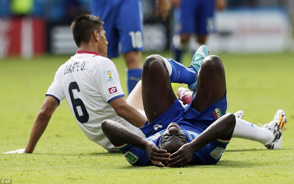 Head in hands: Mario Balotelli, the scorer of Italy's winning goal against England last Saturday, is tackled by Costa Rica's Oscar Duarte
