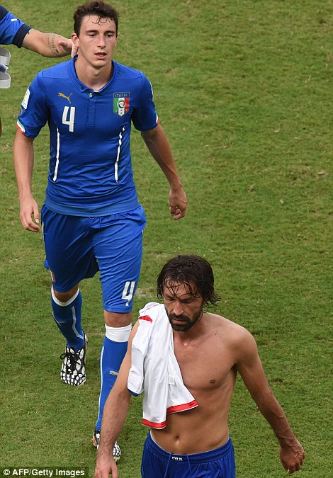 Italy's defender Matteo Darmian (left) and midfielder Andrea Pirlo leave the pitch