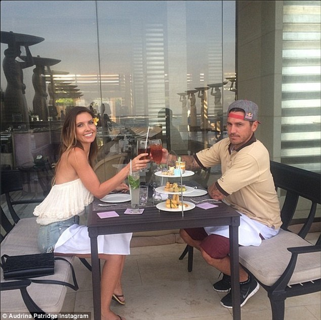 Toasting six years together: With a tropical flower behind her ear, the skinny presenter enjoyed the Mulia's many amenities alongside her on/off Australian beau
