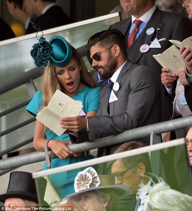 Nag, nag, nag: The pair were seen checking out the best odds on the horses