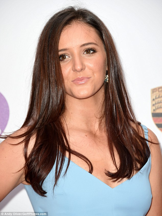 Natural beauty: Laura wore her dark brunette locks tumbling loosely around her shoulders, while opting for simple bronze make-up to highlight her striking features to perfection