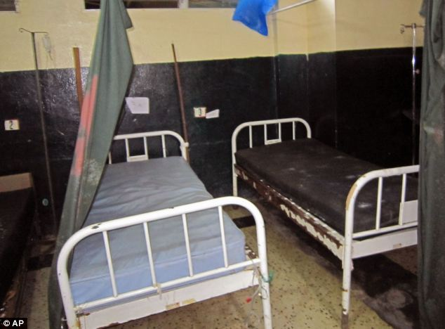 Victims: Empty hospital beds at Redemption Hospital in Monrovia, Liberia after nurses and patients fled the hospital due to a number of deaths. At least 337 people have died since the outbreak started in January