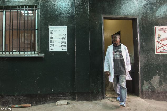 A nurse at the Redemption Hospital in Monrovia, Liberia where a health worker reportedly died of Ebola virus