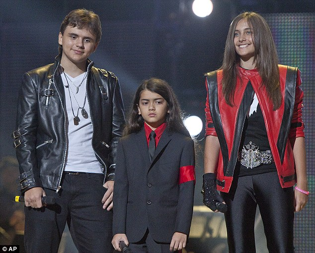 Prince, Blanket and Paris Jackson pictured on stage at the Michael Forever the Tribute Concert in Cardiff in October, 2011 (The children are supported by the earnings)