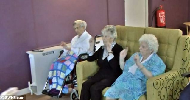 These ladies are really enjoying participating in the video for Happy from the comfort of their armchairs